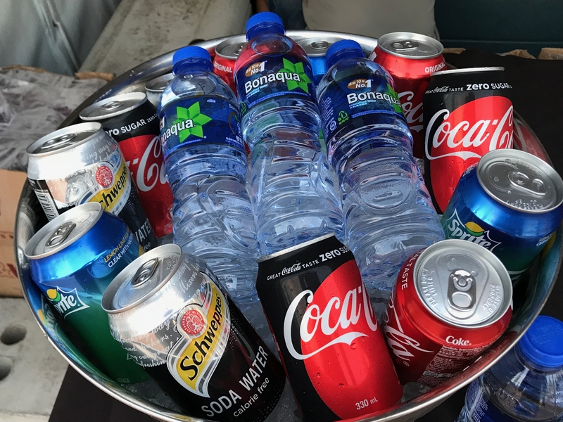 various of canned drinks served on the stainless bowl