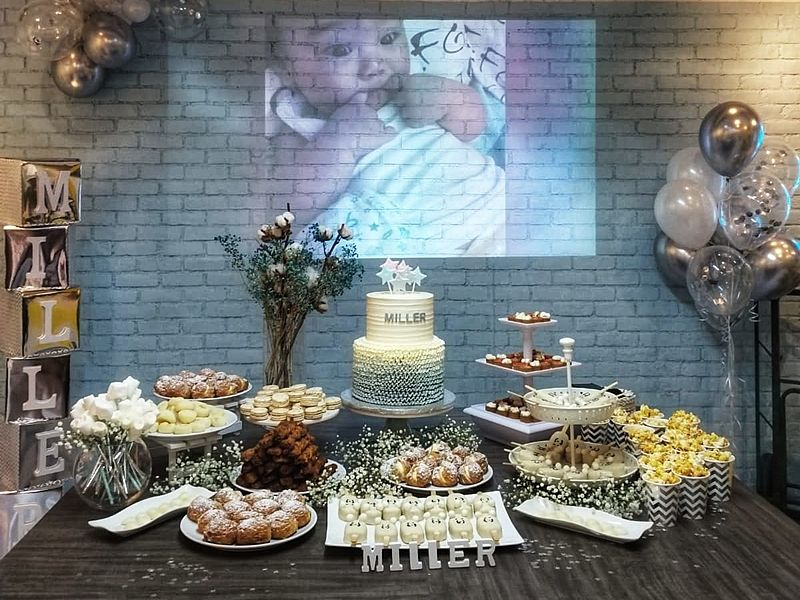 buffet foods served at baby's birthday party with silver balloons