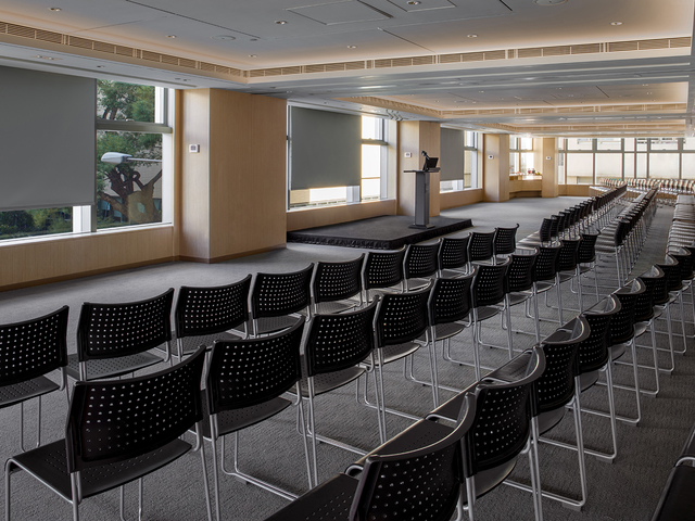 spacious function room prepared for corporate seminar