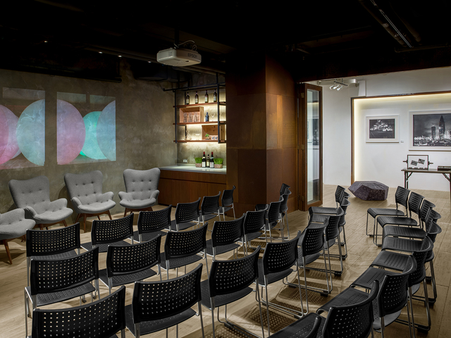 company seminar using theatre seating and area for speaker