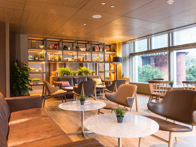 business lounge area with floor to ceiling window