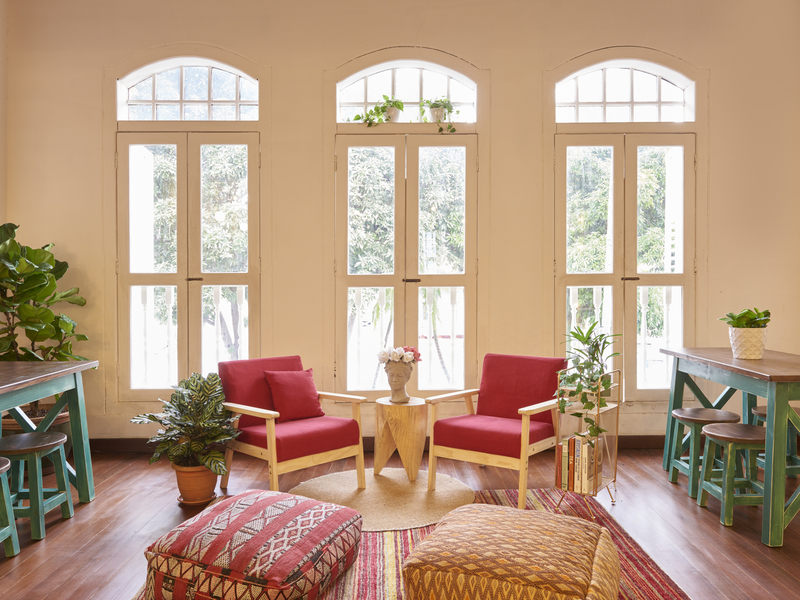 homie event space with dutch style windows and patterned furnitures