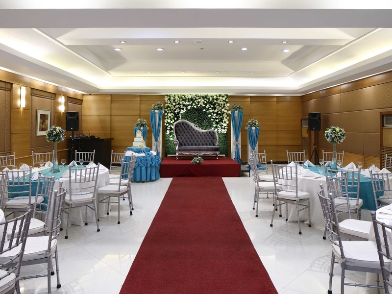 hotel ballroom with high ceiling and wedding decoration