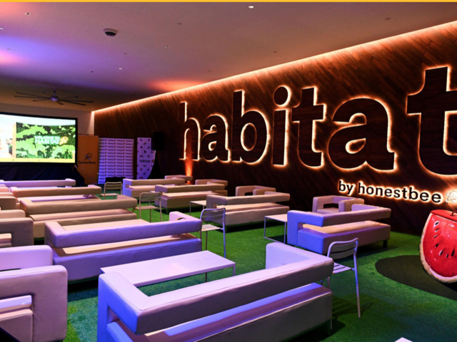 private room using artificial grass floor and habitat sign age on the wall
