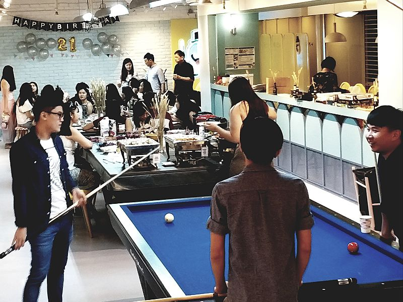 people play billiards at 21st birthday event