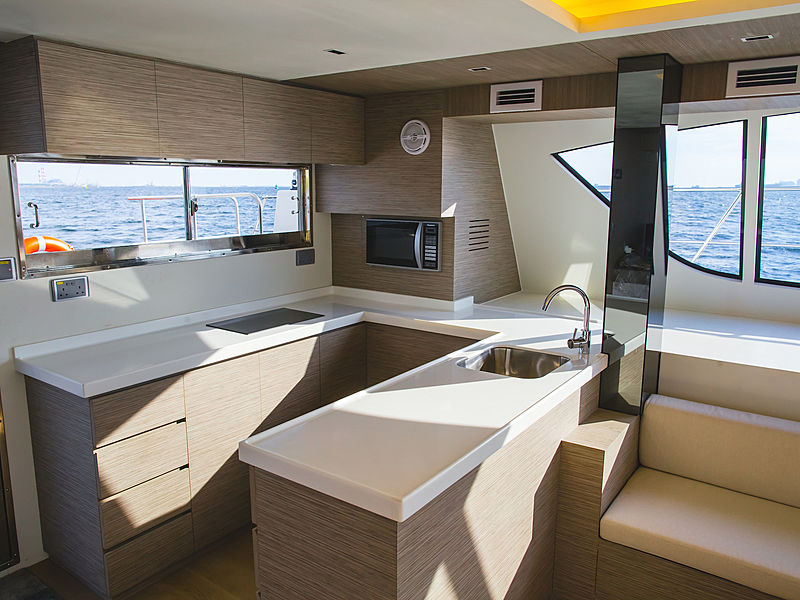 kitchen area inside the yacht by catamaran kucinta