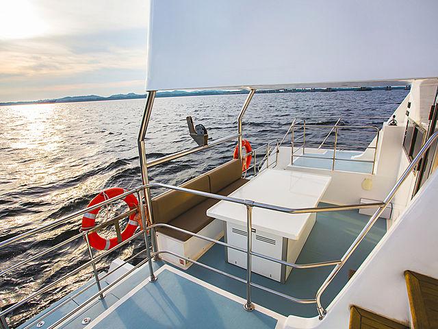 side deck of catamaran kucinta to enjoy the sunset