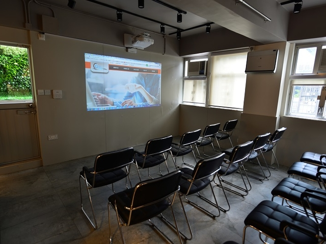 thatre seating style inside the private room equipped with audio visual setting