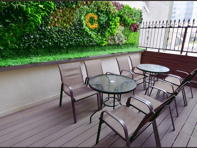 outdoor terrace with forest theme background