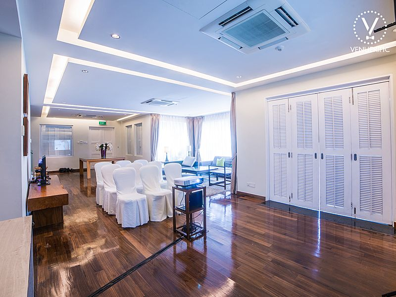 elegant mansion with coporate event set up with white and brown interior