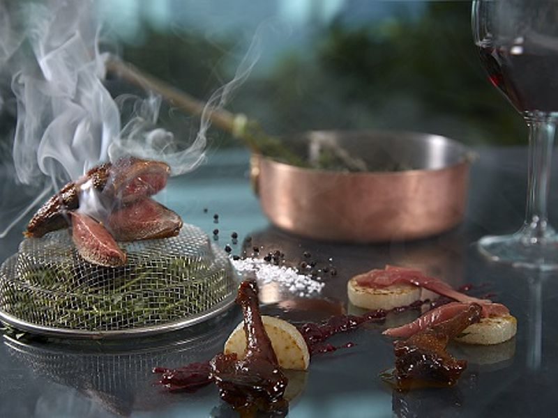 food table display with smoke on the food's top