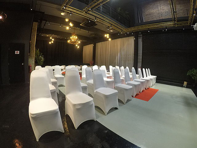 corporate seminar setup with chair using cover