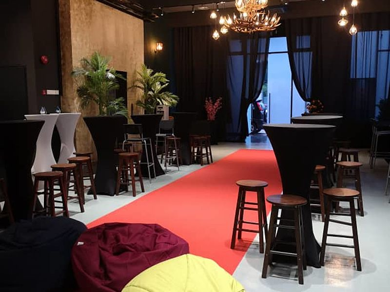 standing party setup with red carpet and bean bags