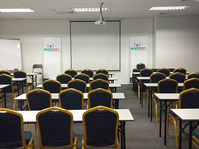 minimalist event space for seminar with screen projector