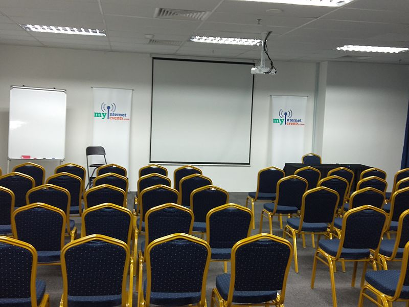 seminar room in kuala lumpur with projector screen and white board