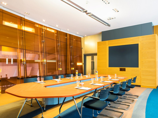 private meeting room equipped with giant screen and tv screen as the visual facilities