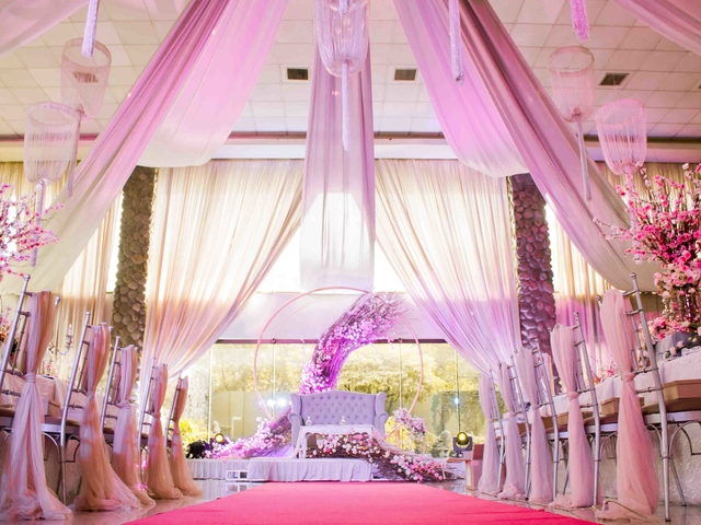 wedding aisle decorated with pink silk