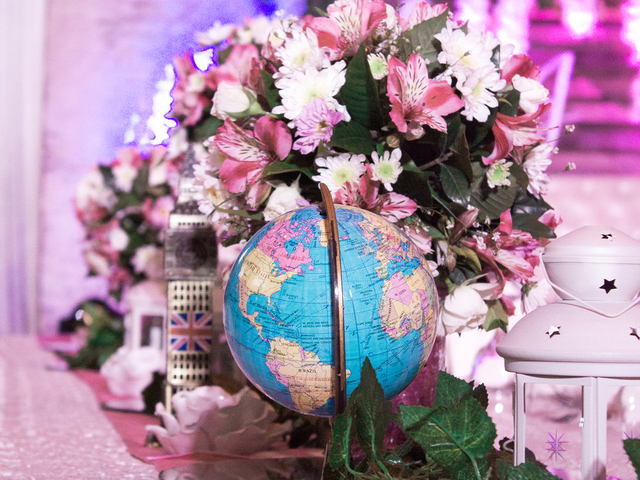 flowers arrangement next to a globe