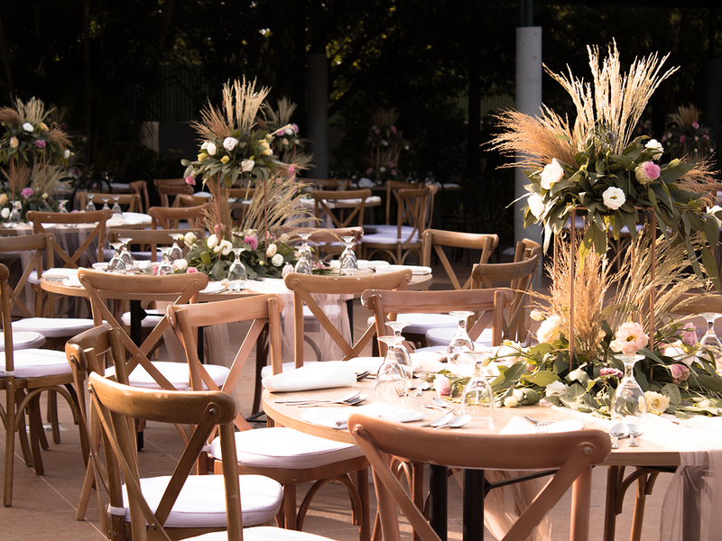 wooden table setup decorated with flowers
