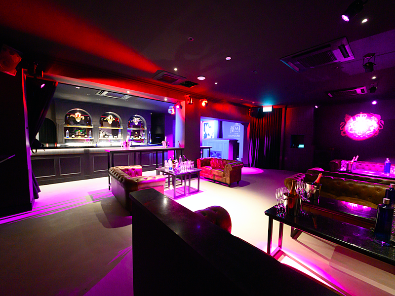 private bar lounge with purple and red lights