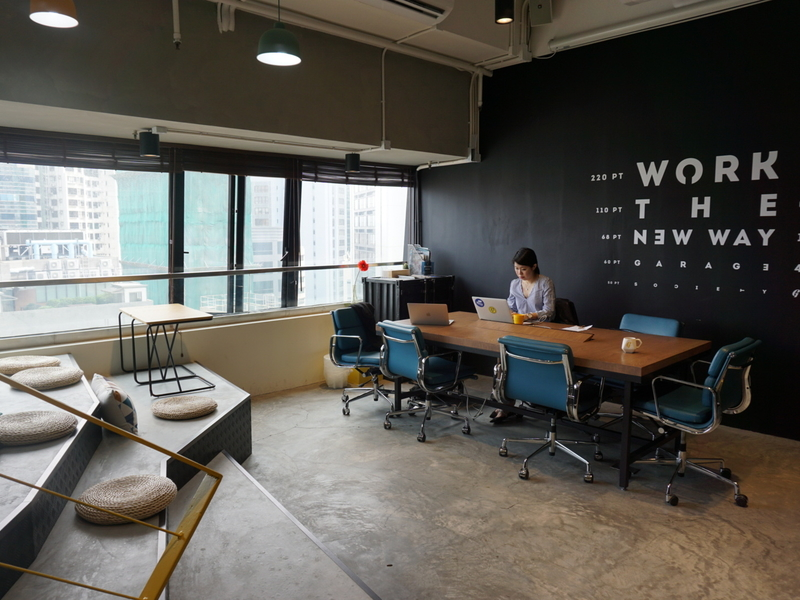 coworking space with quotes on the black wallpaper