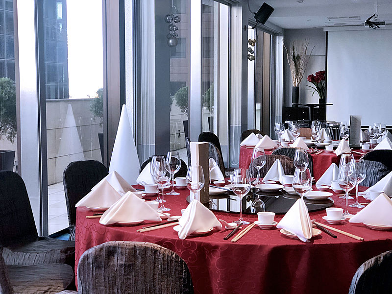 table set up with red tablecloth