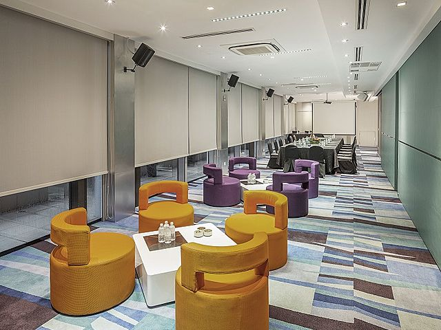 m hotel singapore millenium waiting room with colourful couch