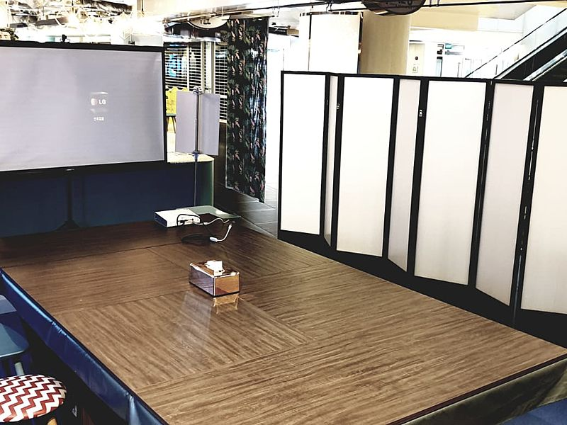 private meeting room with projector screen and folding room dividers
