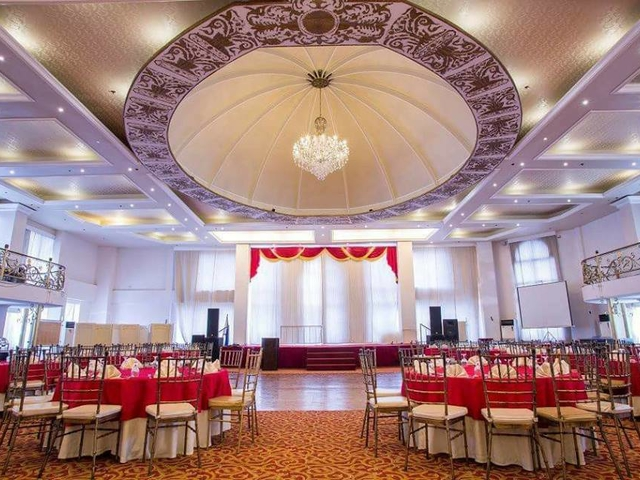hotel wedding ballroom equipped with stage and banquet seating style