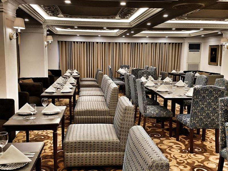 business lounge and dining area with sofa tables setup
