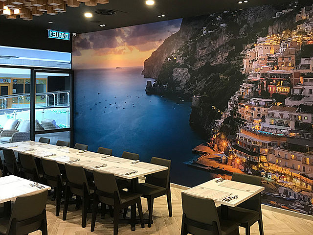 kuala lumpur restaurant with long table and large wallpaper