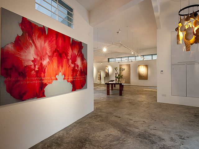 art gallery red painting and high ceiling