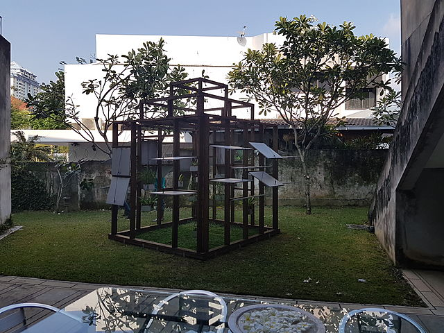 outdoor art exibitions filled with trees and grass