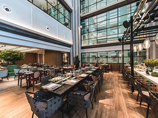 wooden floors cafe inside a tall glass building