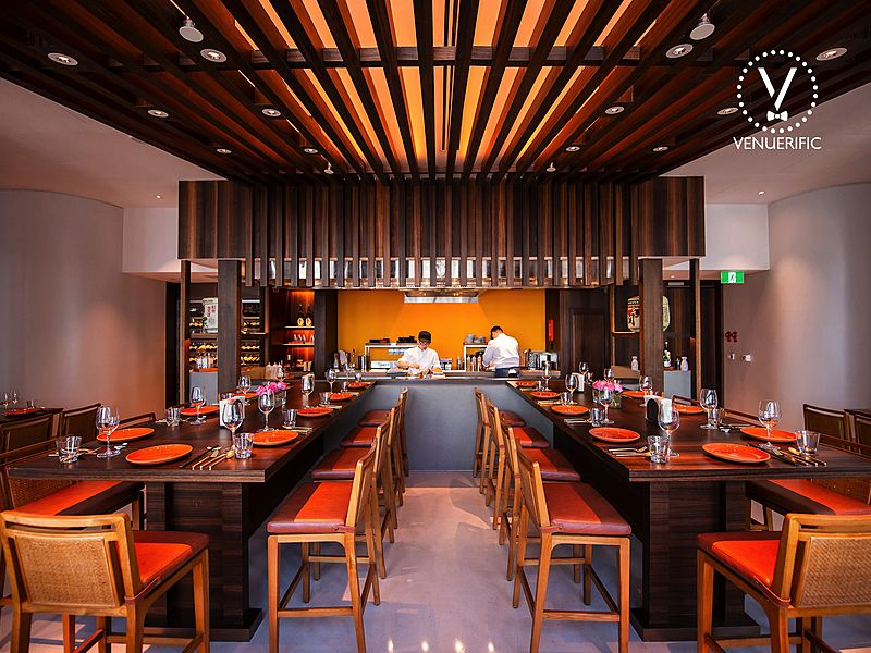 japanese restaurant in singapore with wooden ceiling and several long tables