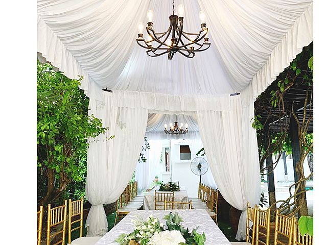 wedding dining table covered with white tent