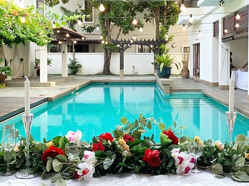 malaysia poolside wedding venue decorated with flowers