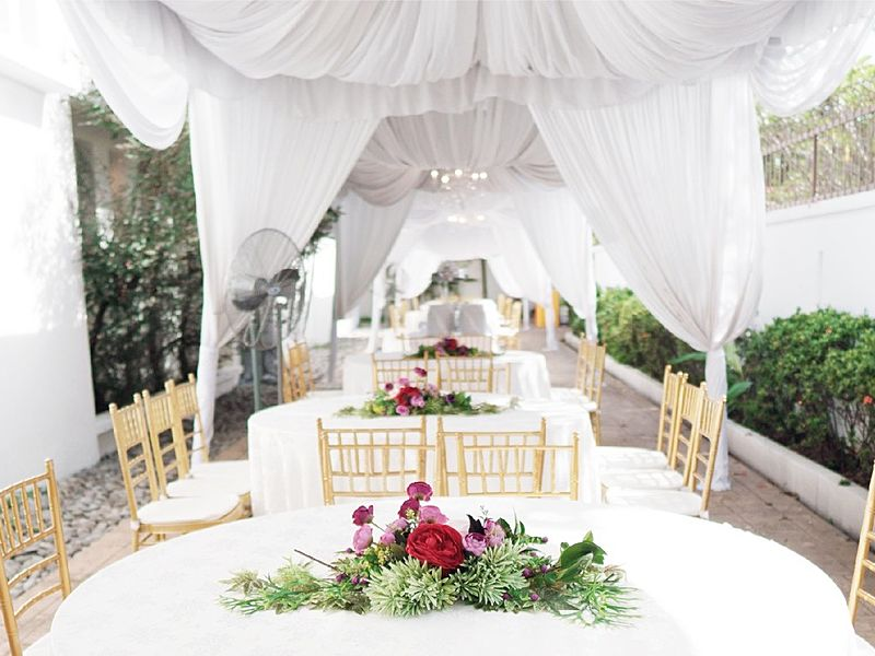 semi-outdoor wedding event space covered with white tent