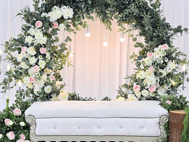 intimate wedding venue malaysia decorated with flowers and white couch