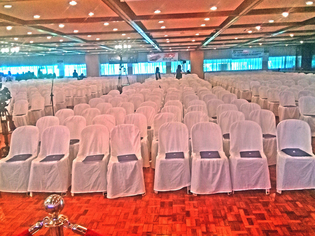 manila large function room with white audience chairs and high ceiling