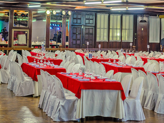 company anniversary party venue in pasig with long dining tables and high ceiling