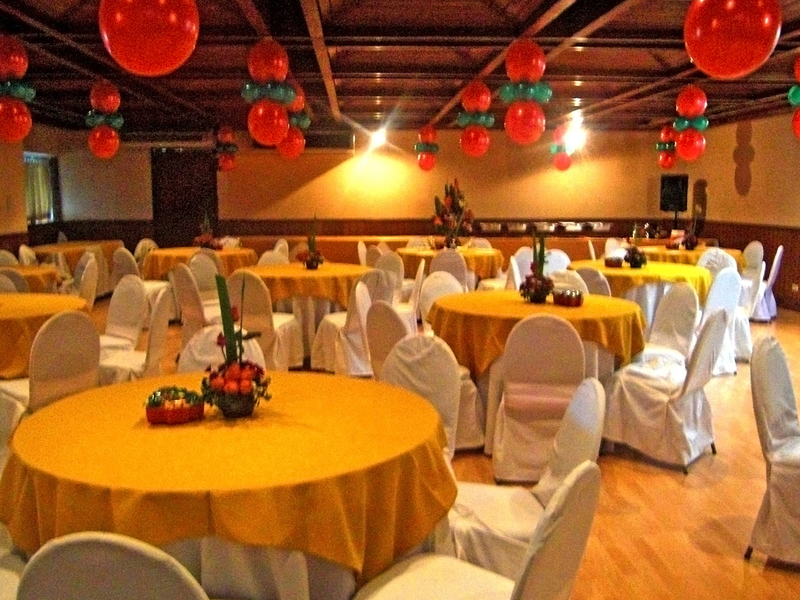 large event venue with round table set up covered with golden cloth