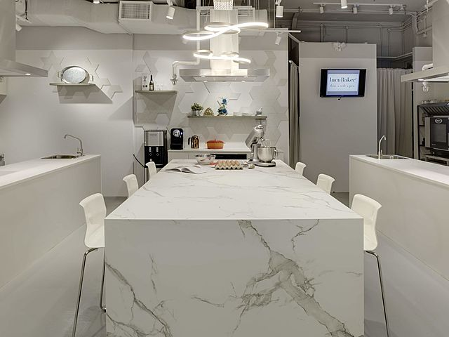 marble table and white chair in cooking studio with all white themes