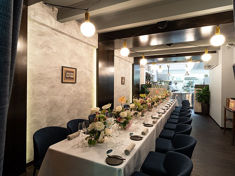 white long table decorated with flowers in singapore restaurant