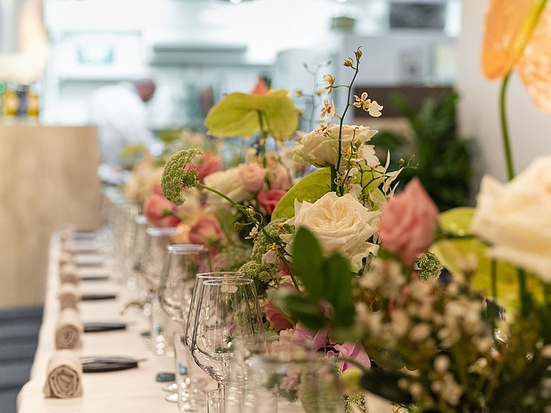 singapore venue decorated with white long table and flowers for engagement party