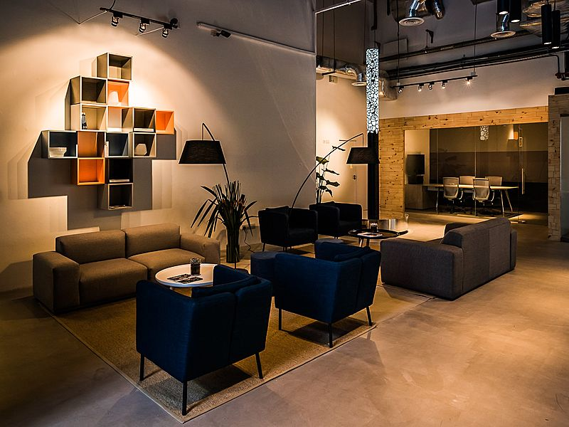 coworking space public lounge with several couches and track lighting