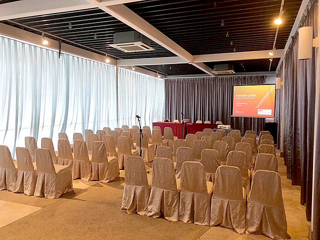 set up for seminar with white chairs and screen projector