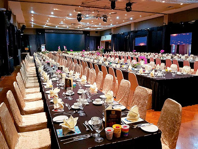 long table set up for gala dinner in ballroom