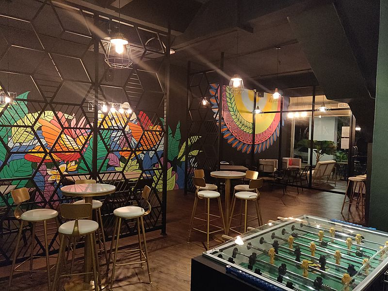 penang small restaurant with foosball game and colourful wall painting
