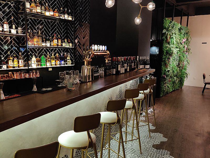 wooden floors bar with drinks display in penang